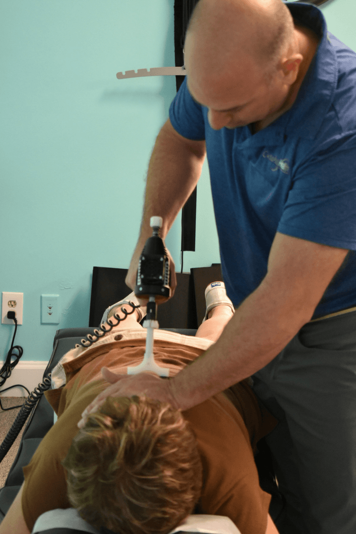 Dr. Neil doing chiropractic care